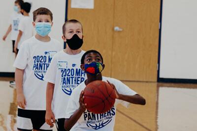 masked athletes at summer basketball camp