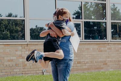 parent hugging their lower school sudent