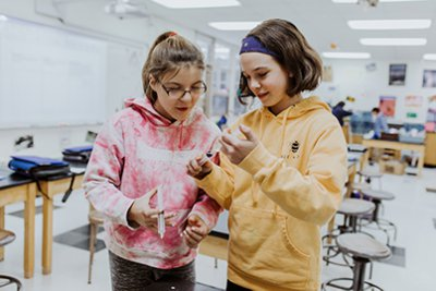 two middle school students in the science lab