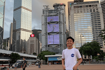 Justin Choi in front of skyscrapers