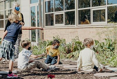 kindergarten exploring in the new garden