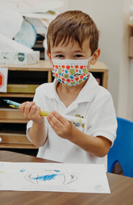 perk student coloring with his mask on