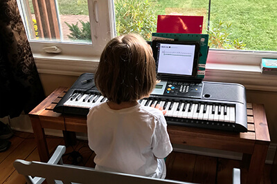 Eloise playing piano