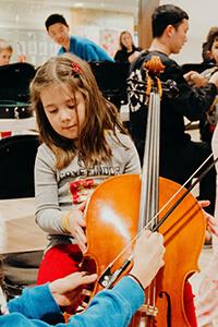 Eloise tries the Cello