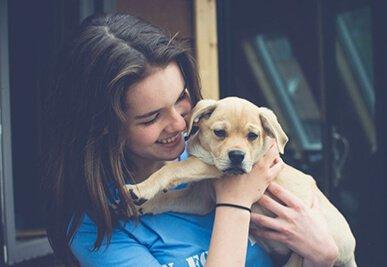 Sammie Garrity with a puppy