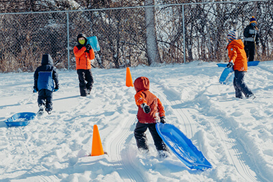 lower school students playing in the snow