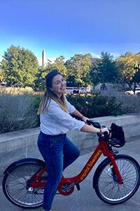Katherine Garvey on a bicycle