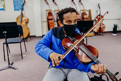 Ibrahim Playing the Violin