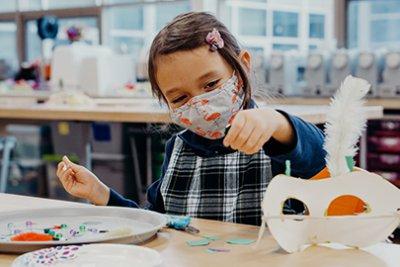 Kindergarten student working in the Makerspace