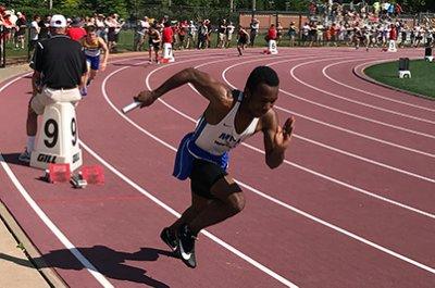 Upper school student racing in track meet