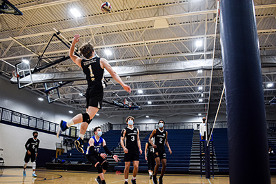Luke Zscheile smashes a spike in the Lansing Sports Center