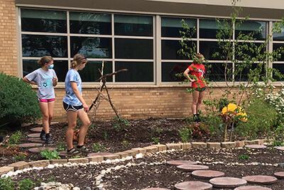 student volunteers working in the garden
